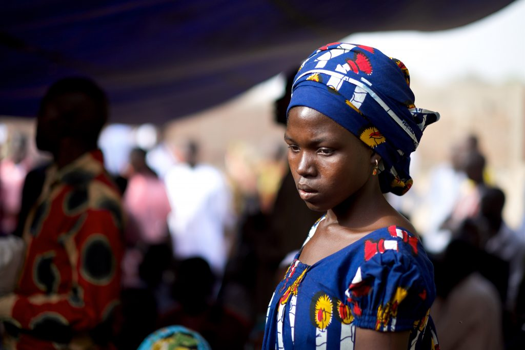 Woman from Chad in a blue dress